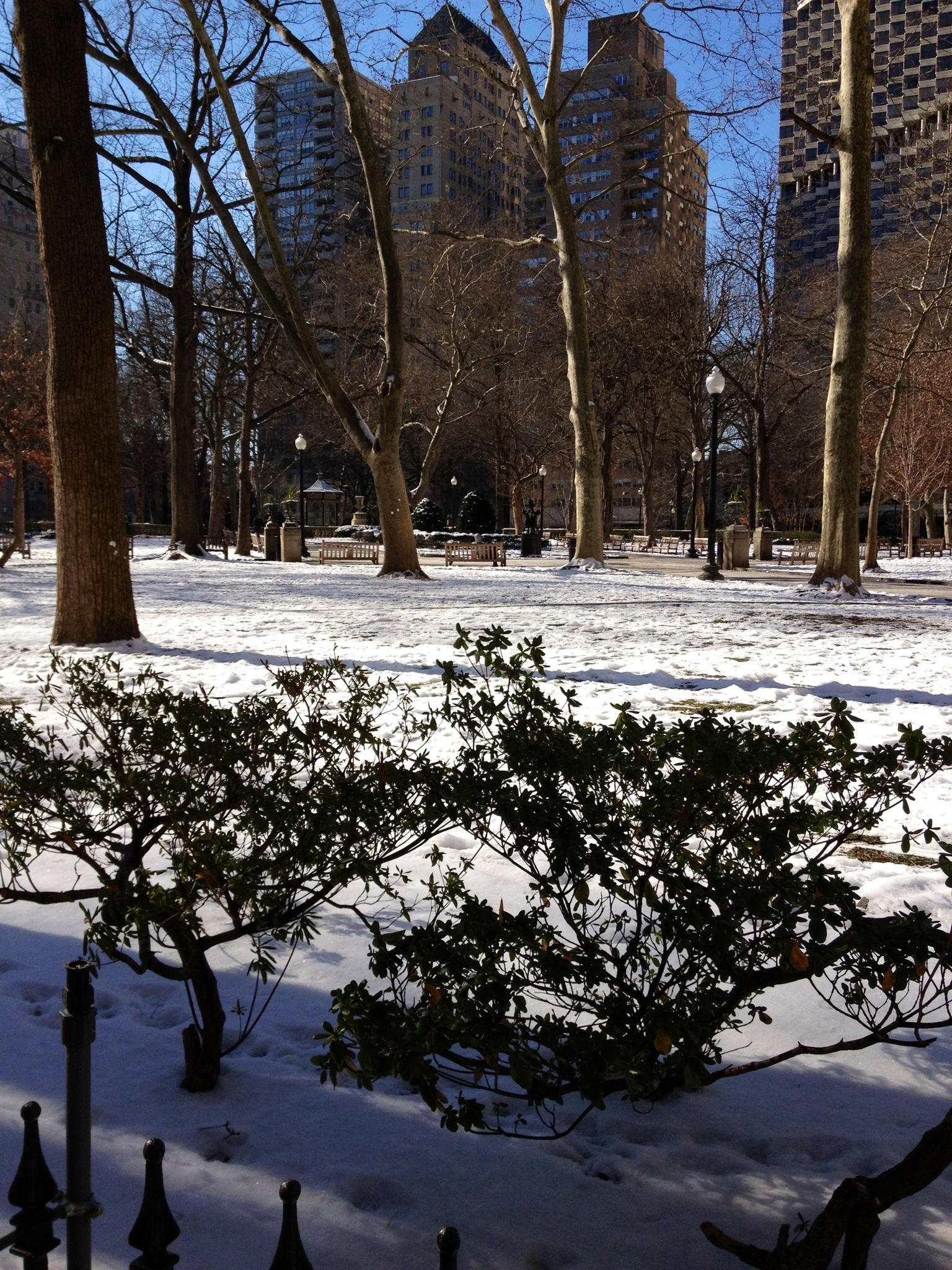 Rittenhouse park in Philadelphia, PA on a sunny, snowy winter day via Her Philly.