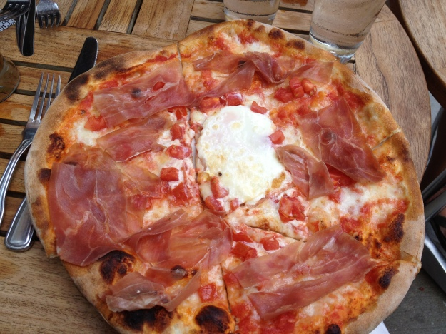 tomato, mozzarella, prosciutto, sliced tomato with one egg pizza from Serafina in Philadelphia