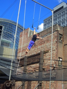 Instructors and Staff from Fly School Circus Arts teaching the PIFA Daringly High Trapeze Class, on Broad Street in Philadelphia all April long / Her Philly